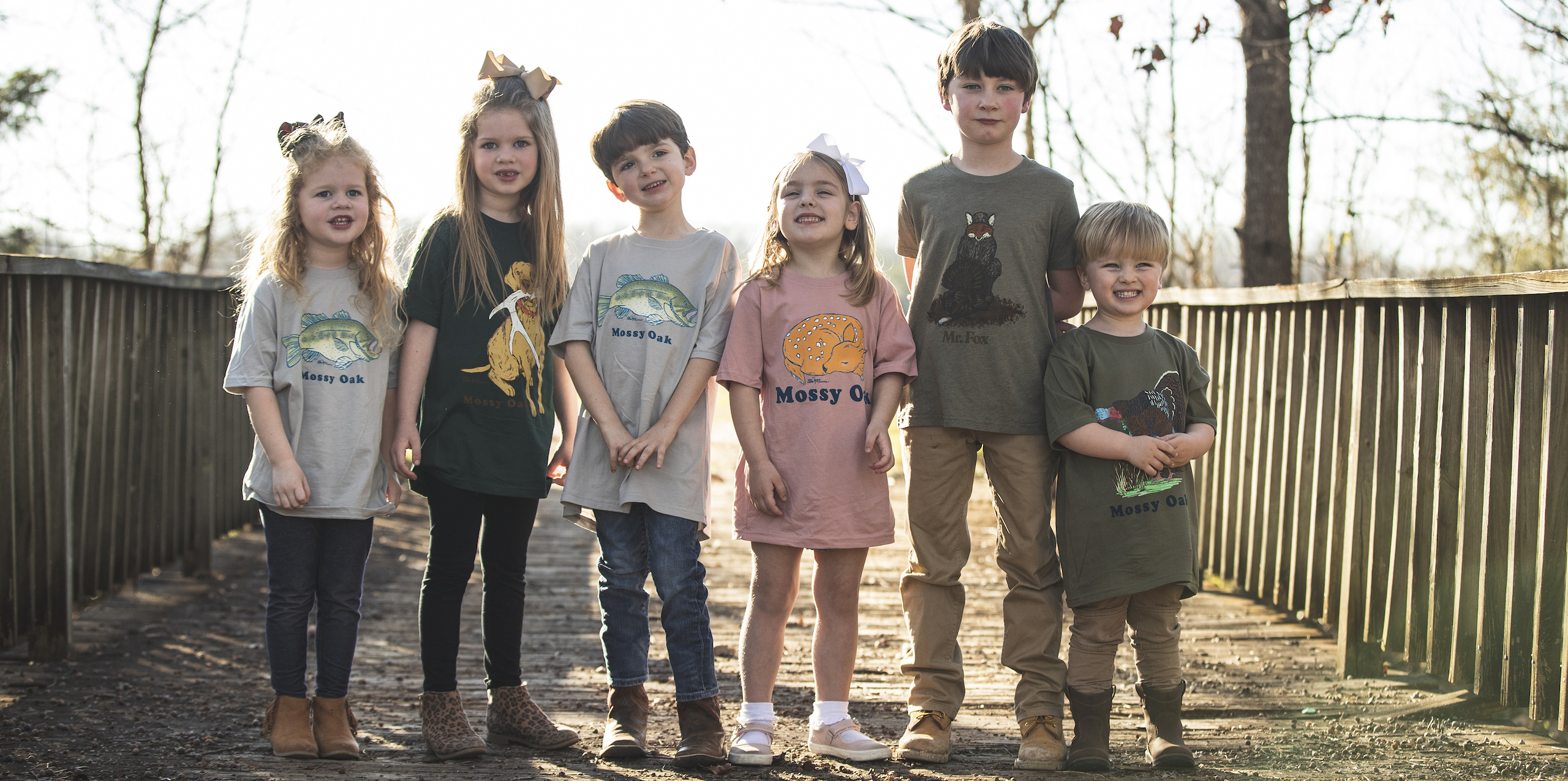 Young kids model various Mossy Oak T-shirts